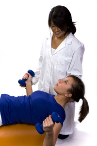 doctor helping patient with dumbells
