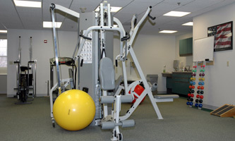 workout equipment and yellow excersise ball